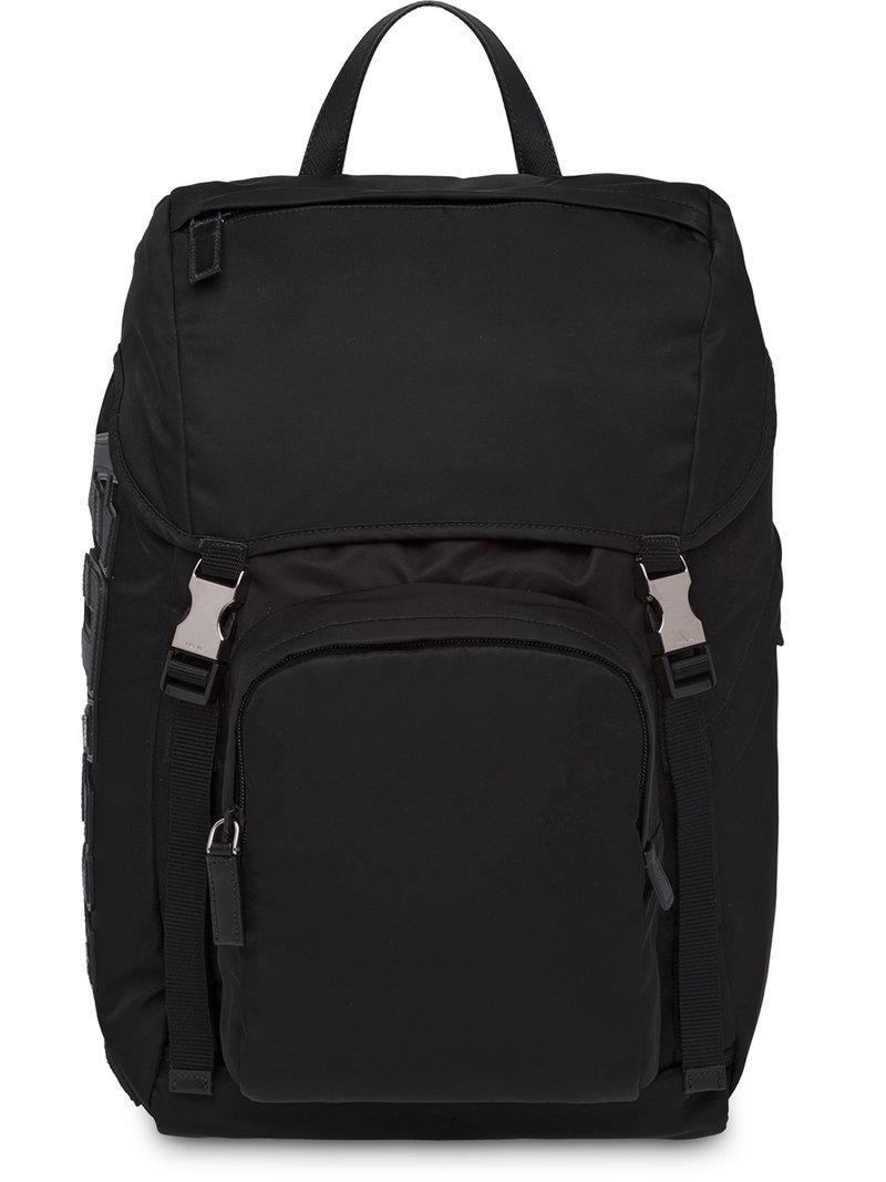 Prada Logo Appliqué Backpack in Black for Men - Lyst 0732a306405af