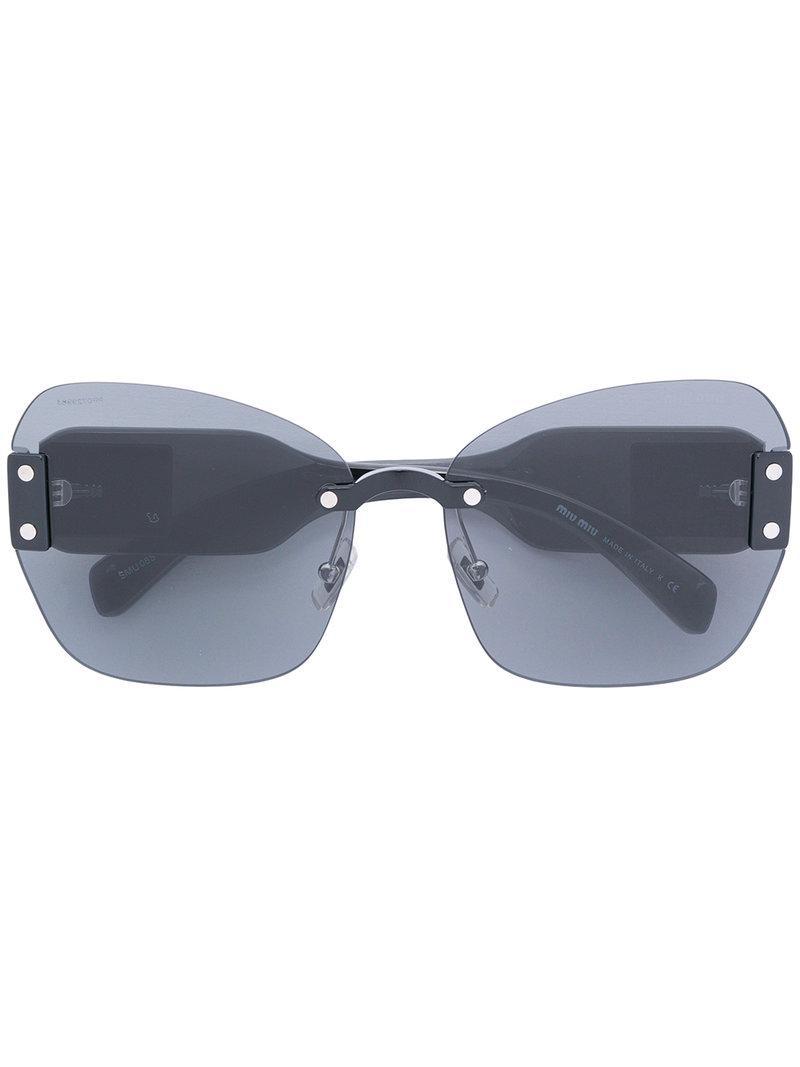 57a38640bf74fe Miu Miu Oversized Logo Sunglasses in Black - Lyst