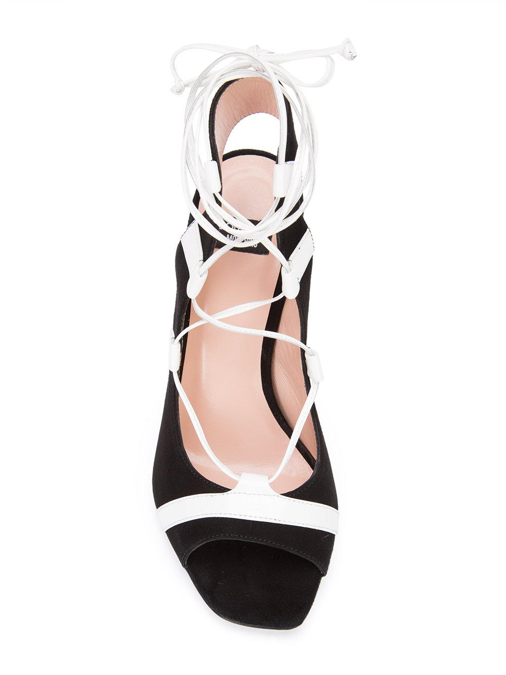 96114125ce7 Boutique Moschino - Black Striped Sandals - Lyst. View fullscreen