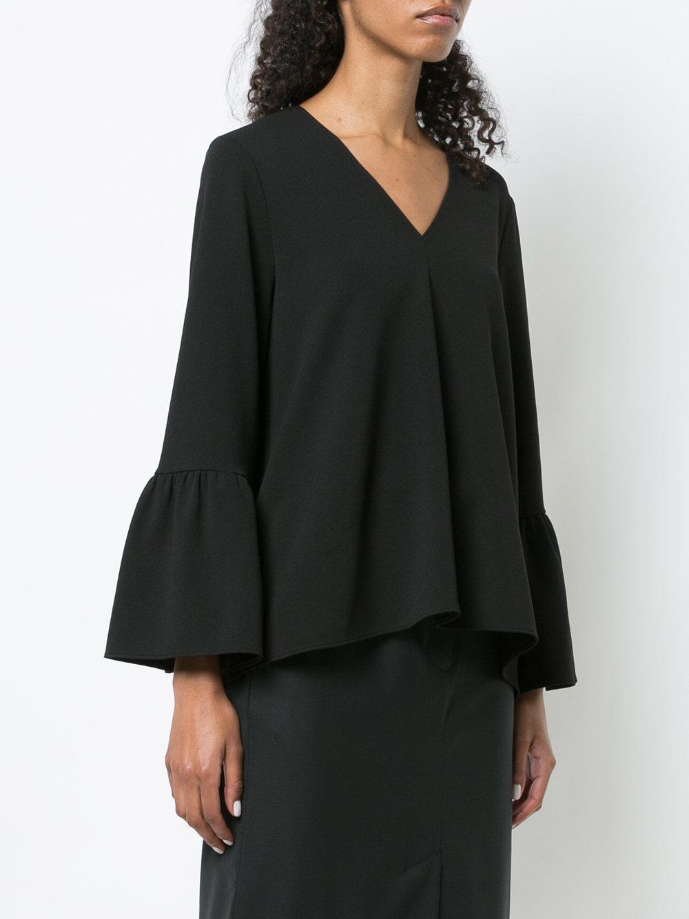 Blusa con cuello en V de manga con volantes Tibi de color Negro