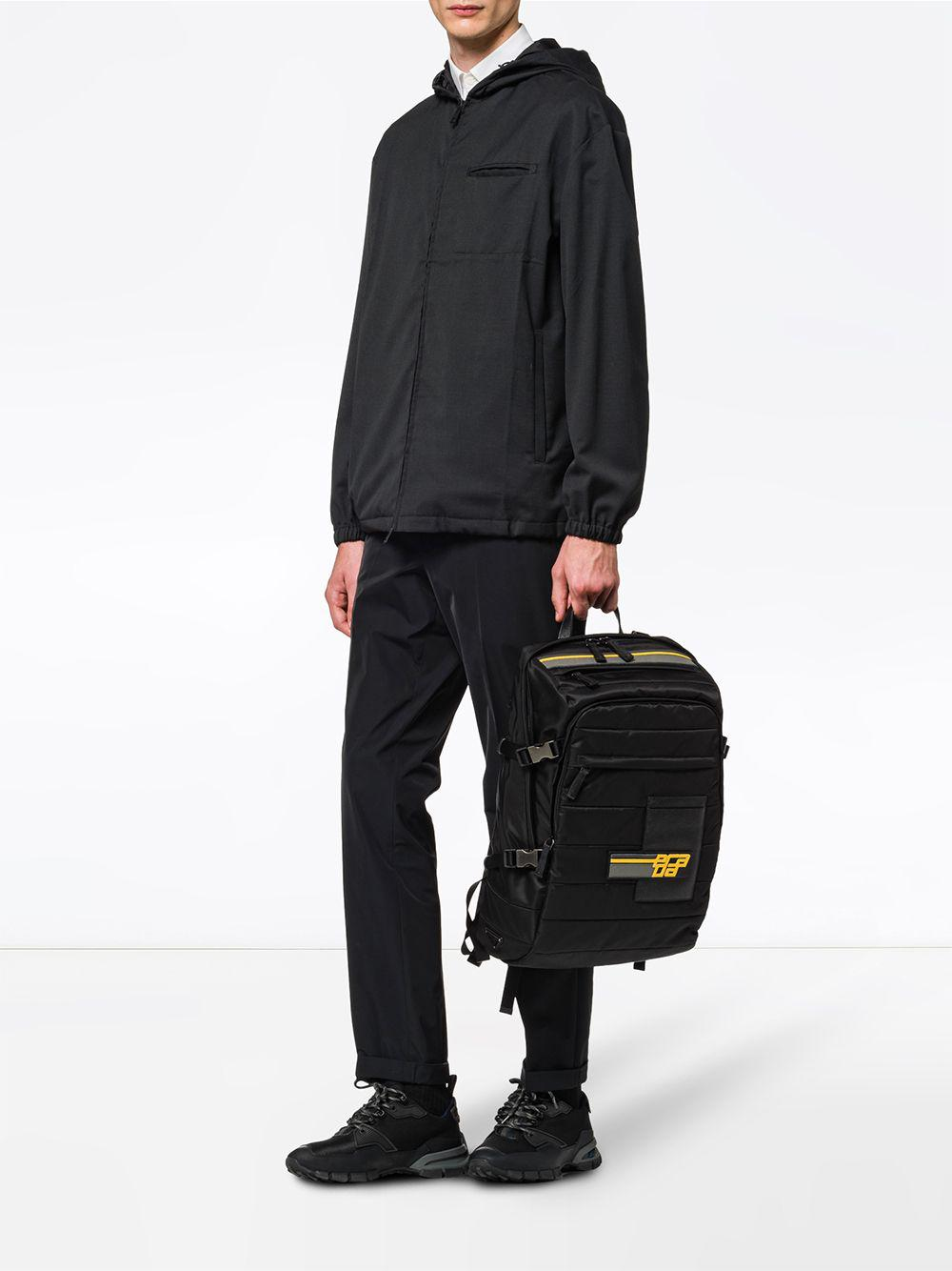 69abd4d8c2c5a7 czech prada black logo patch backpack for men lyst. view fullscreen 3f2ce  48e14