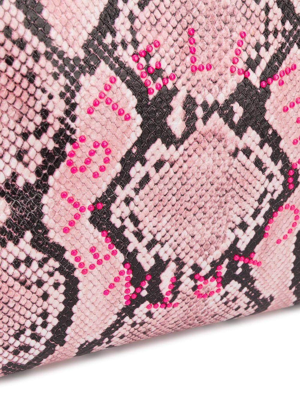 Pochette à effet peau de serpent Cuir Stella McCartney en coloris Rose