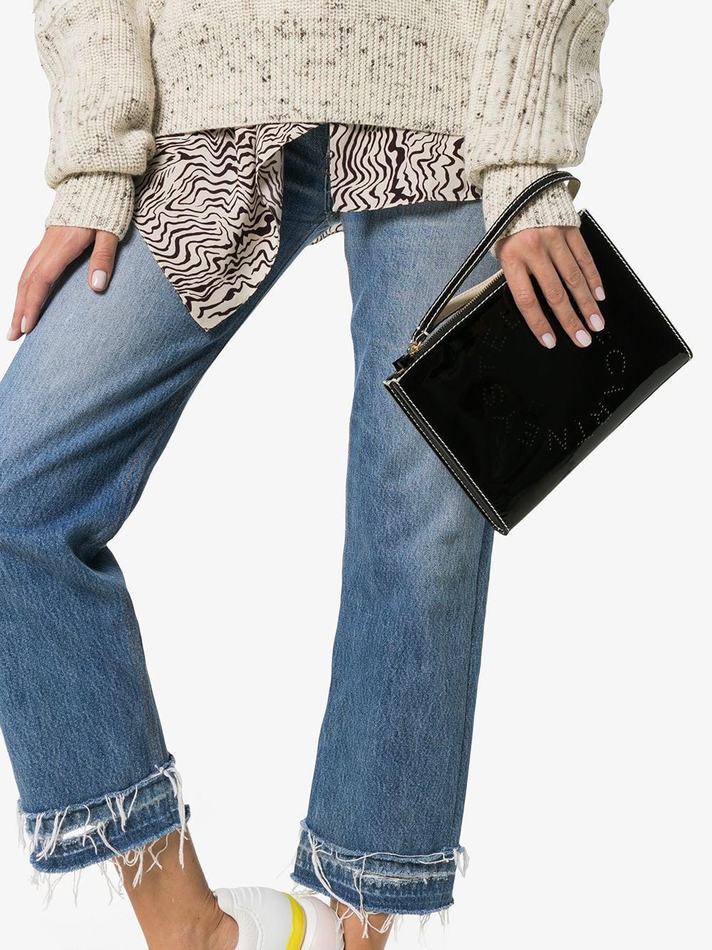 11f781440211 Stella McCartney - Black Logo Print Faux Leather Zip Clutch Bag - Lyst.  View fullscreen