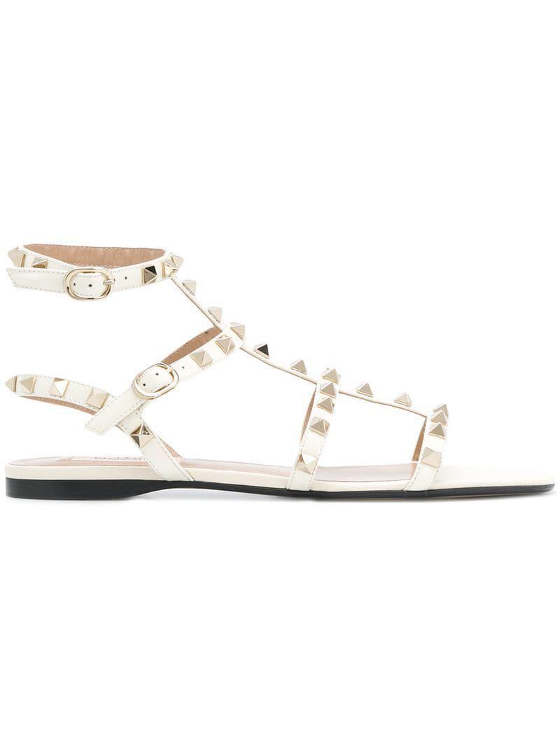 2795123c3c77 Valentino Garavani Rockstud Sandals in White - Lyst
