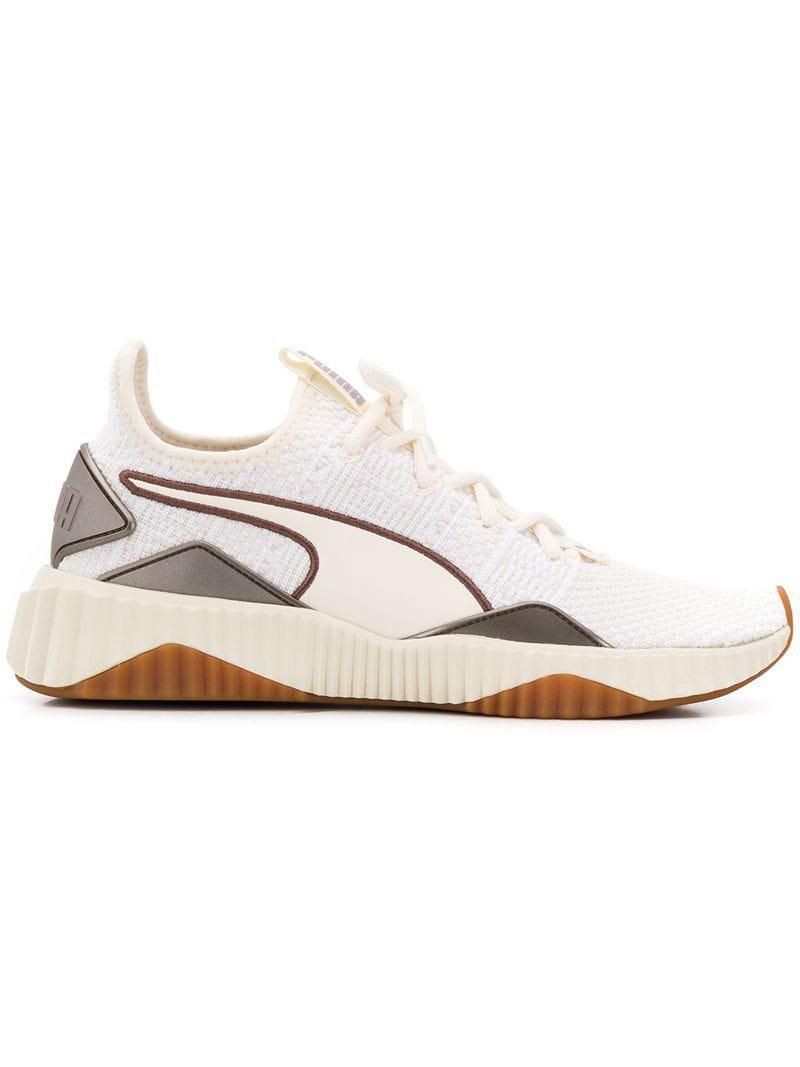 d713641478de55 Lyst - PUMA Defy Luxe Selena Gomez Sneakers in White