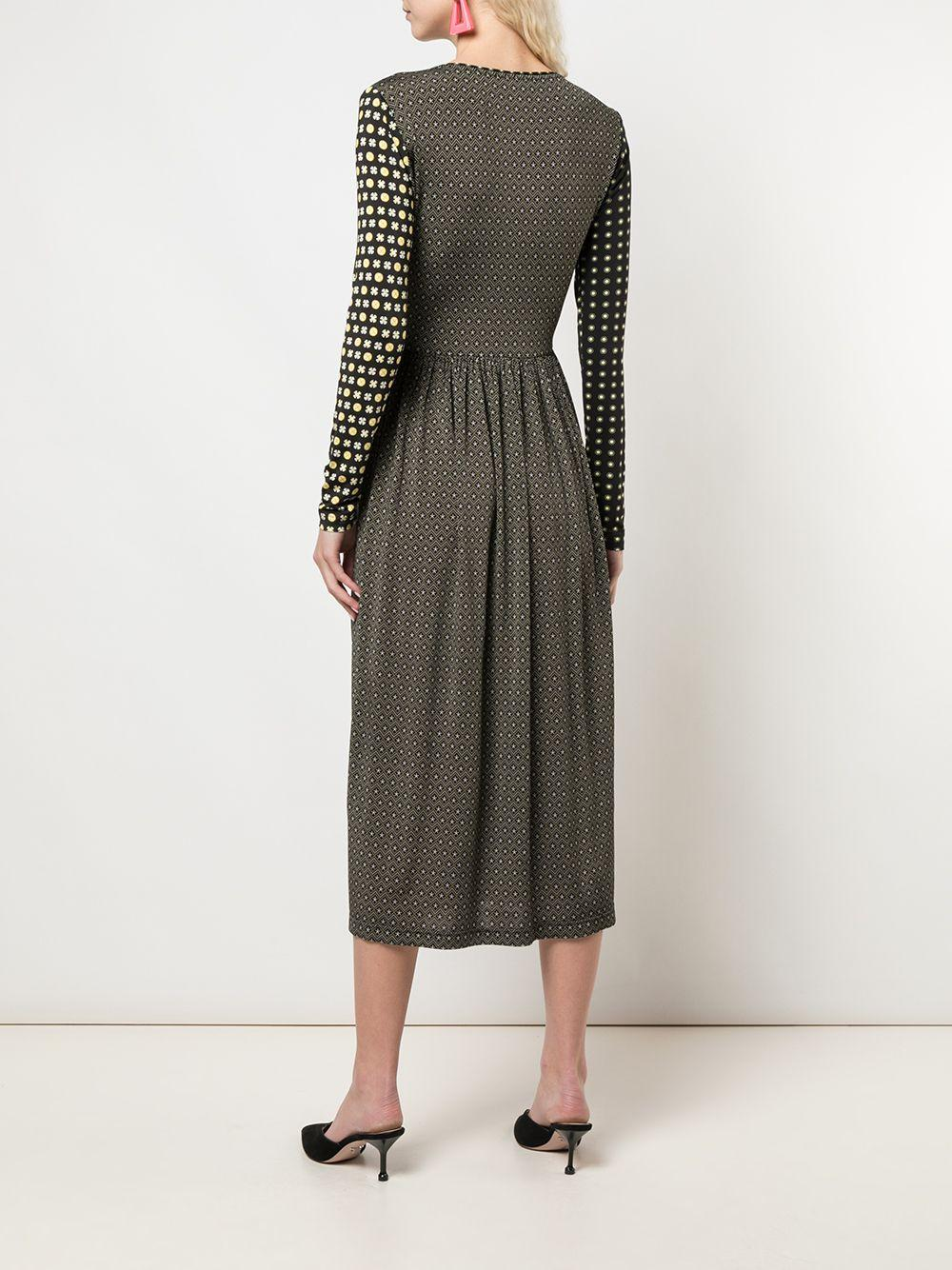 Robe portefeuille mi-longue imprimée Synthétique Stine Goya en coloris Noir