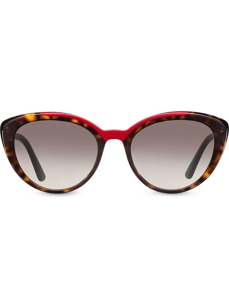 9b3509d917a9 Lyst - Prada Cat-eye Shaped Sunglasses in Brown