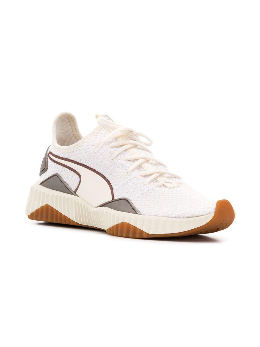 761872f047f0 Lyst - PUMA Defy Luxe Selena Gomez Sneakers in White