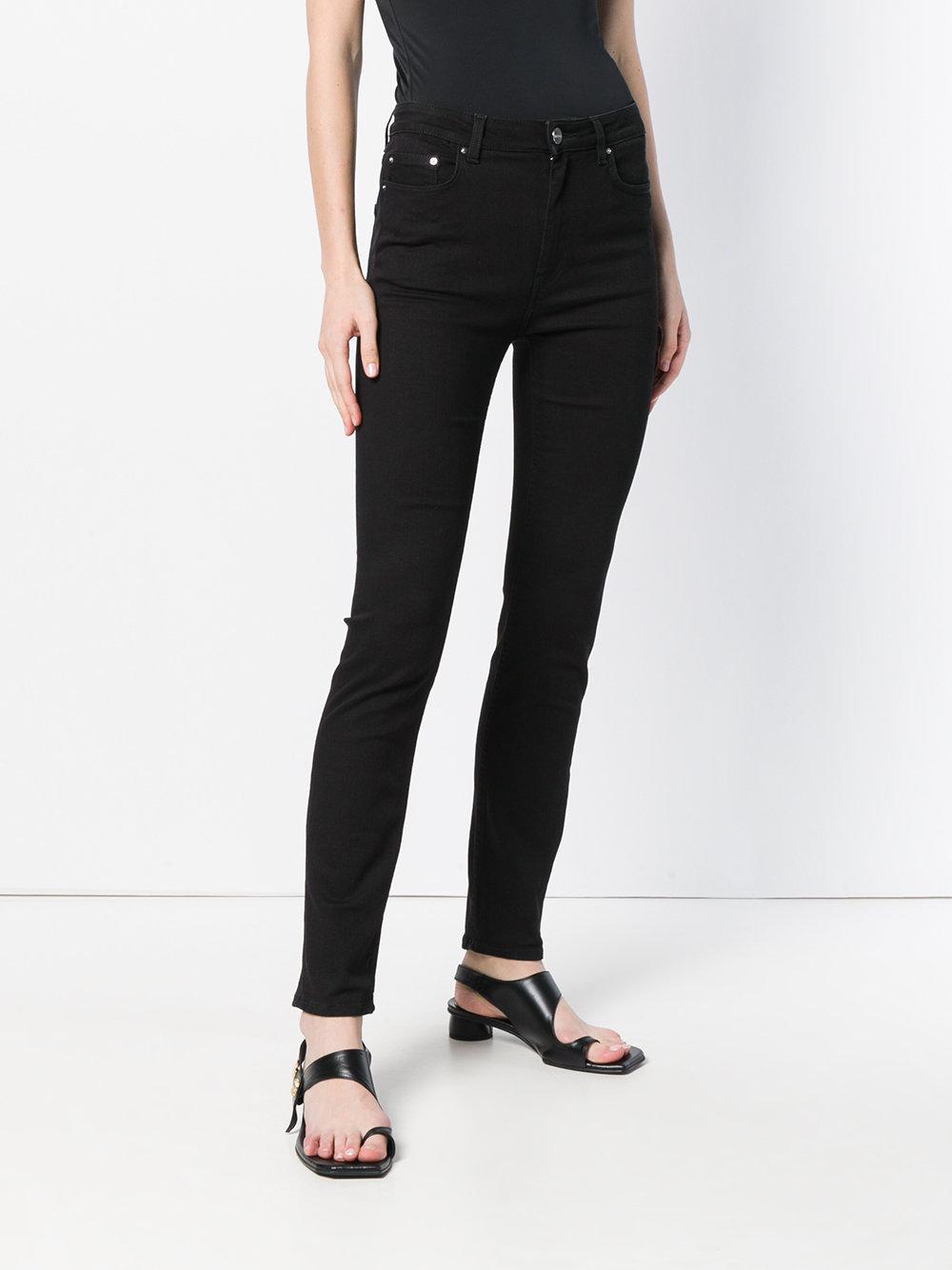 Totême Denim Skinny Jeans in Black