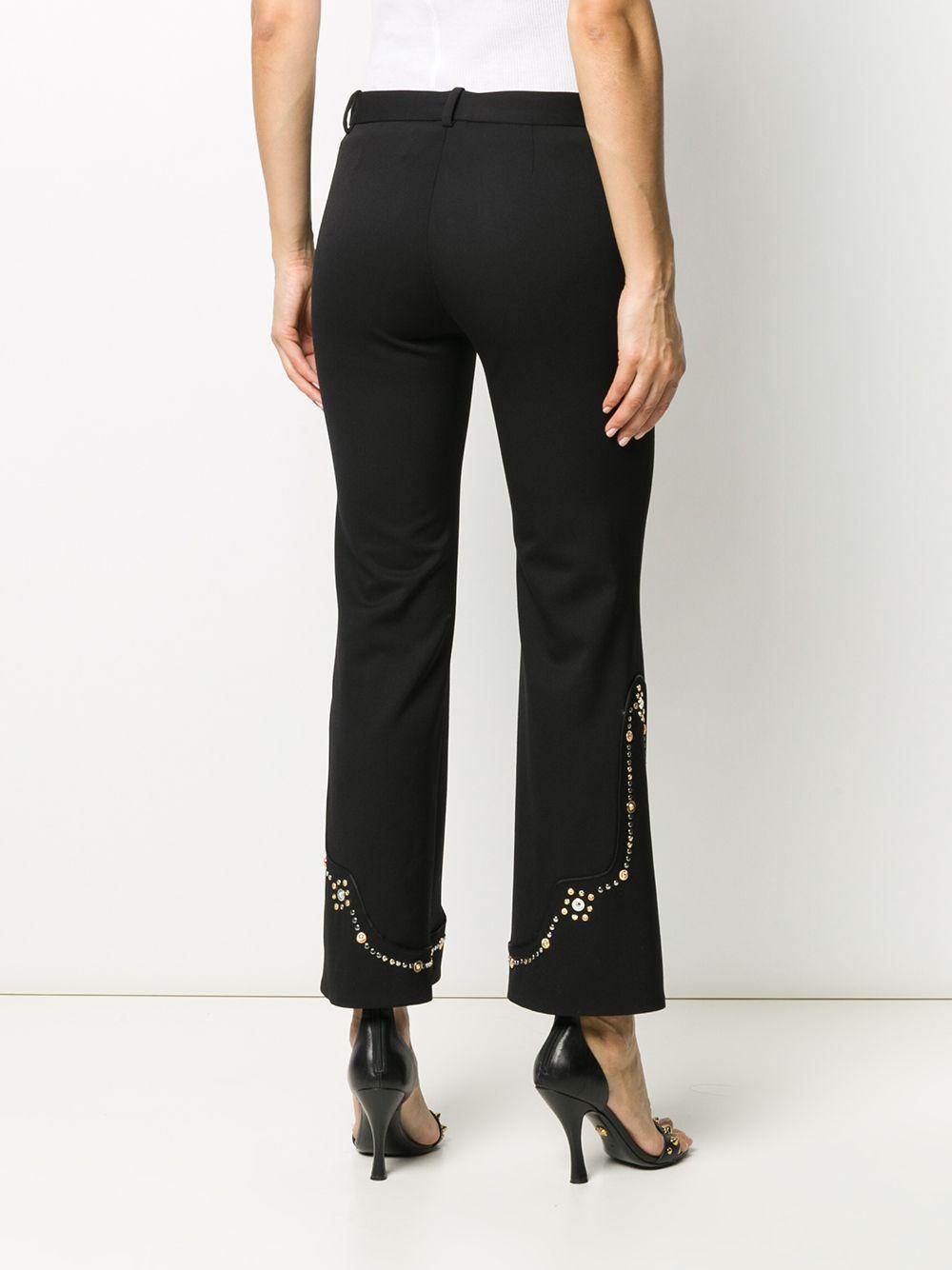 Pantalones acampanados con detalles Versace de Lana de color Negro