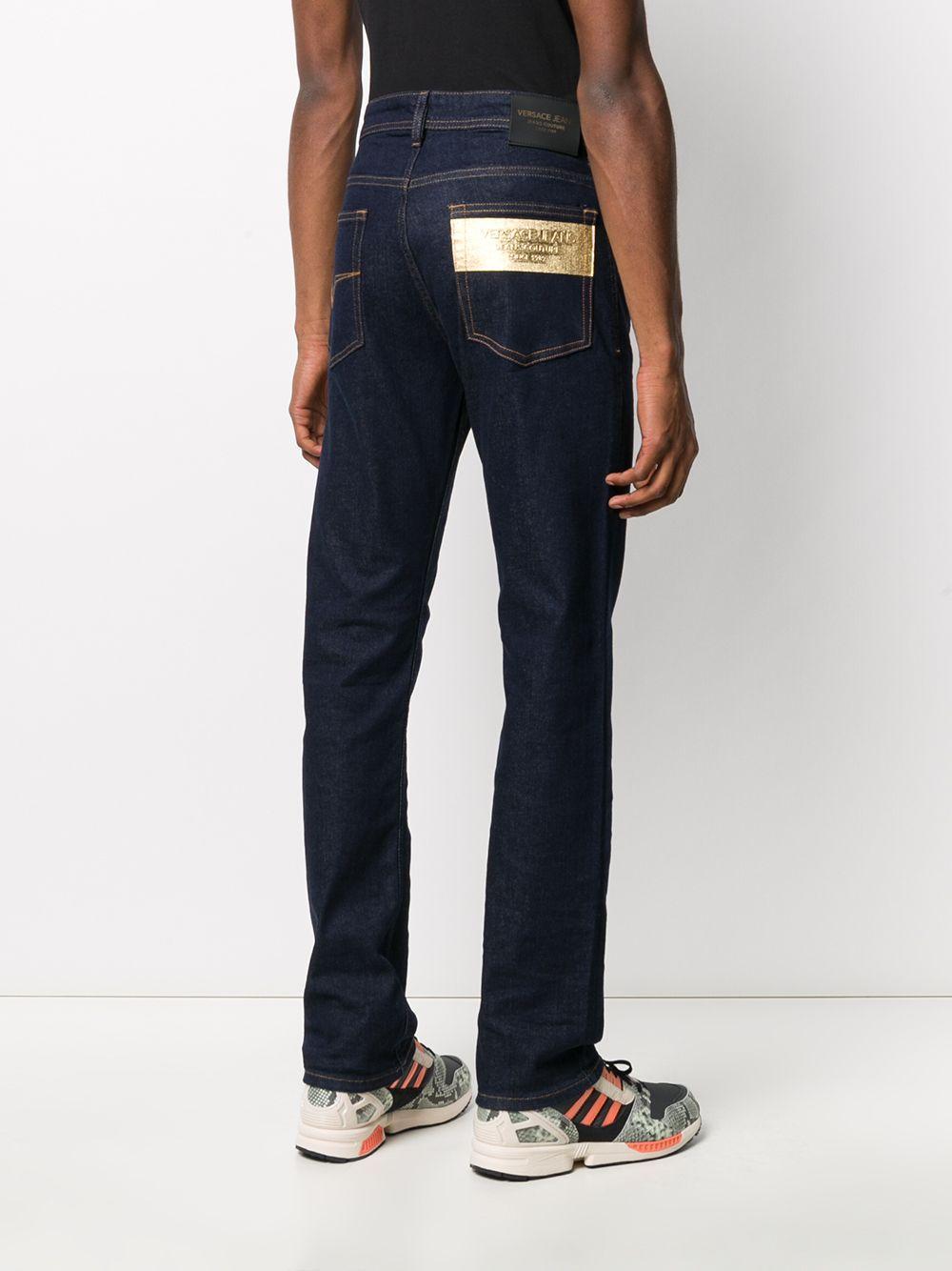 Jeans taglio straight con vita media da uomo di colore blu