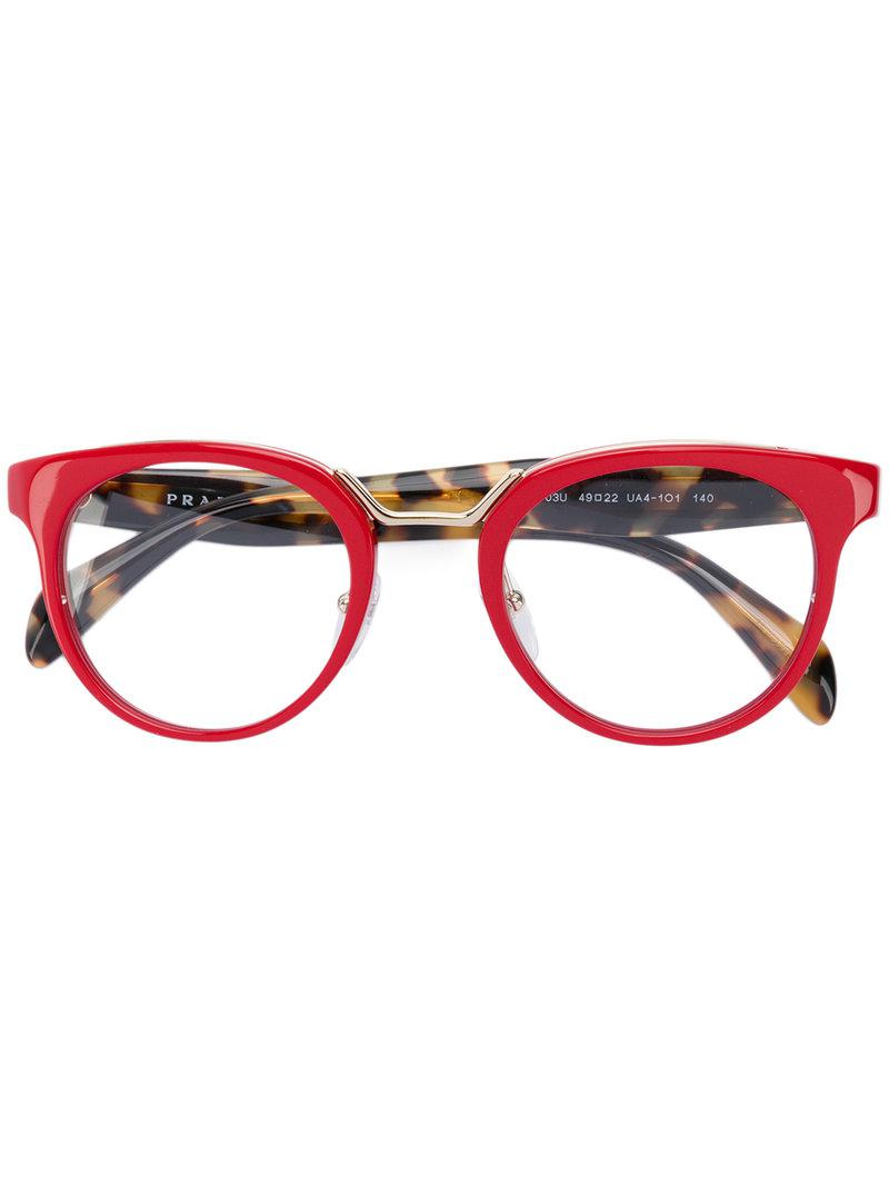 27c7adeabb ... new arrivals prada minimal baroque sunglasses collection luxottica lyst  prada round frame glasses in red a2ca1