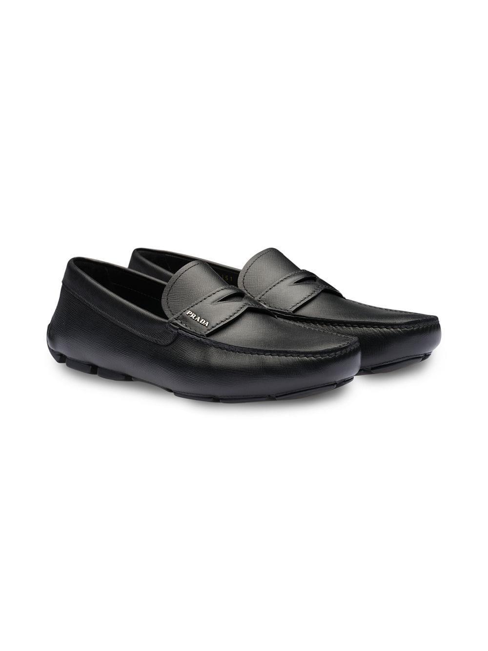 03e6b4f64b3 Prada Saffiano Penny Loafers in Black for Men - Lyst