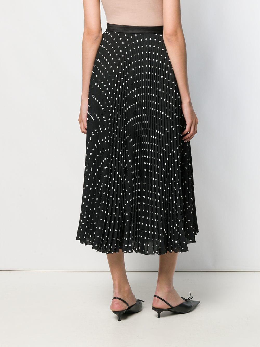Falda plisada con lunares Prada de color Negro