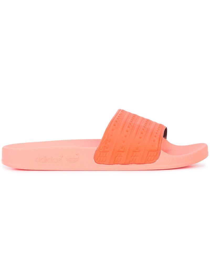56cbdc9a5e66 Lyst - adidas Adilette Slides in Orange