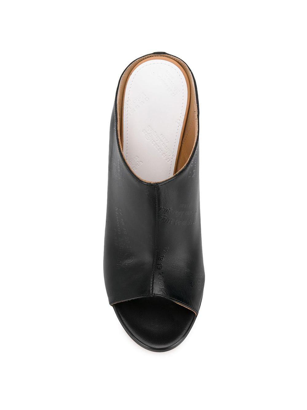 Mules con tacón alto curvado Maison Margiela de Cuero de color Negro
