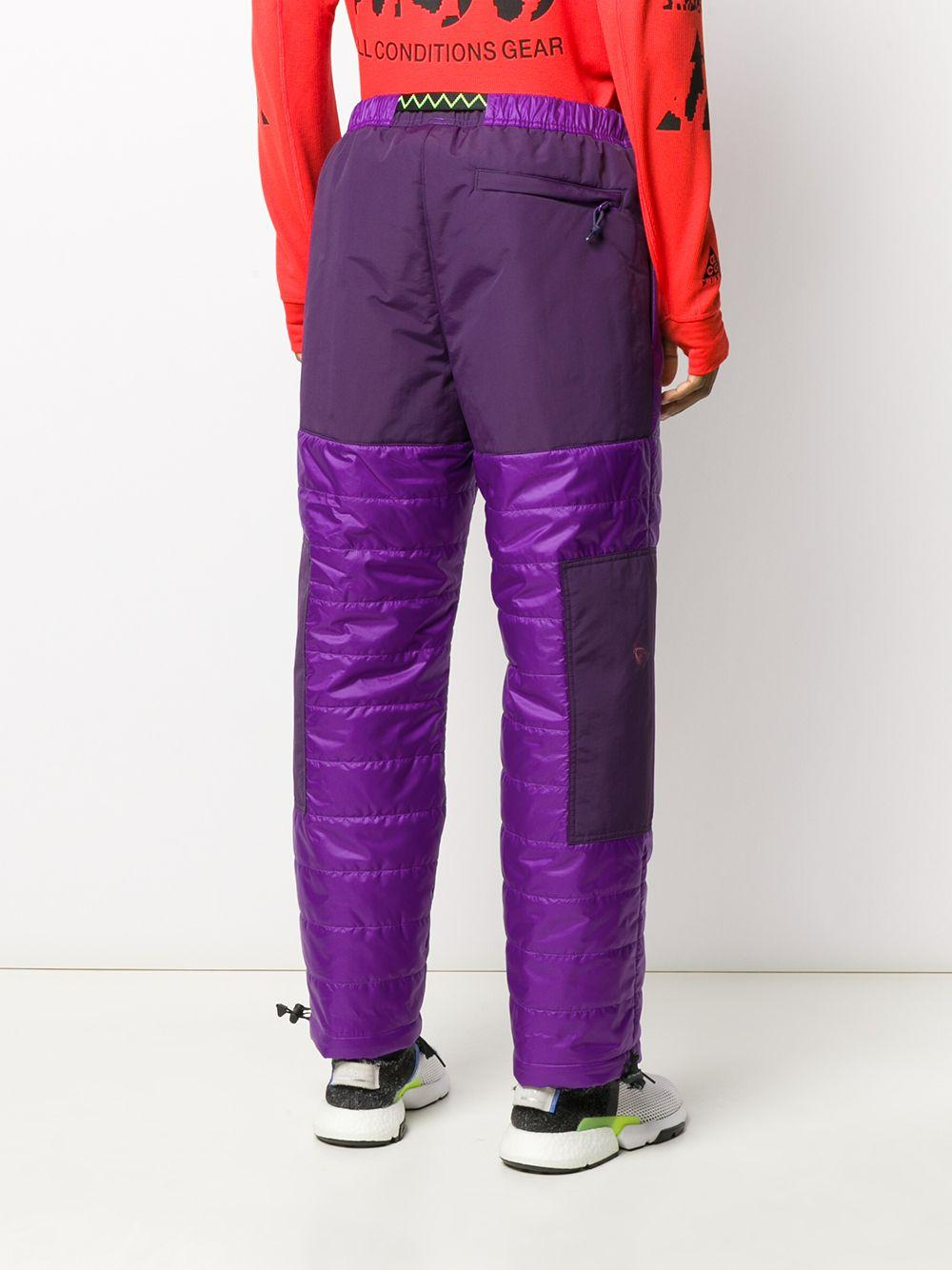 Pantalon fuselé à empiècements matelassés Nike pour homme en coloris Violet