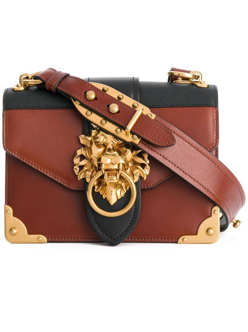 Prada Leather Cahier Lion Embellished Shoulder Bag In