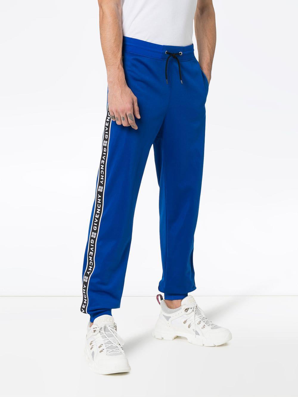 195b9be7aec Givenchy - Blue Pantalon de jogging à bandes logo for Men - Lyst. Afficher  en plein écran
