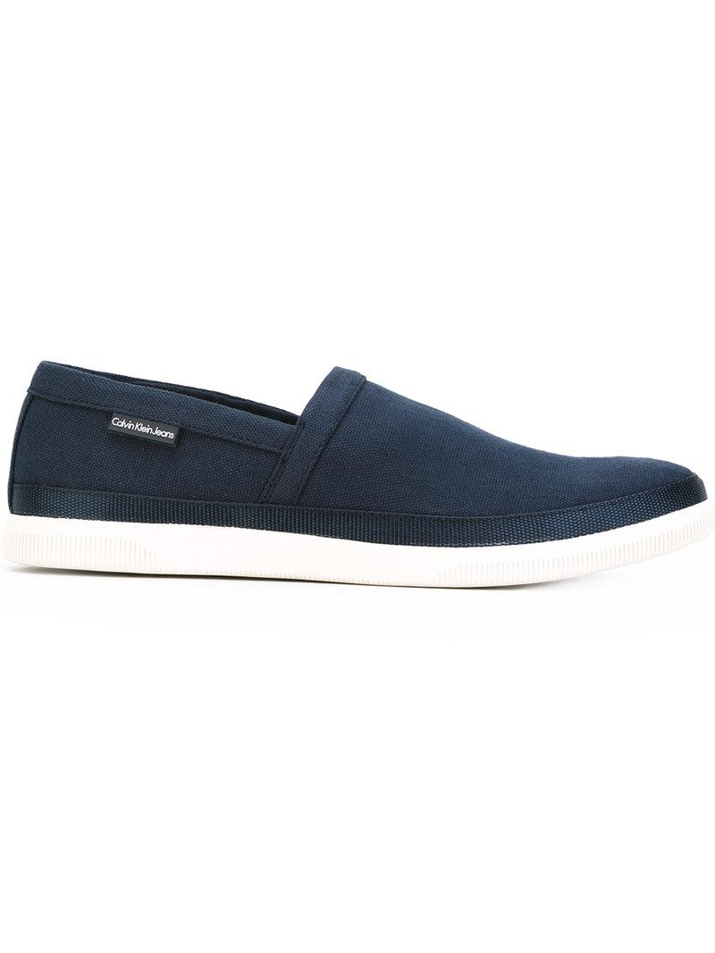 calvin klein slip on sneakers in blue for men lyst. Black Bedroom Furniture Sets. Home Design Ideas