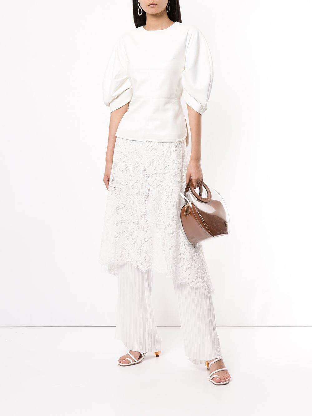 Pantalones acampanados con diseño en capas Goen.J de Chifón de color Blanco