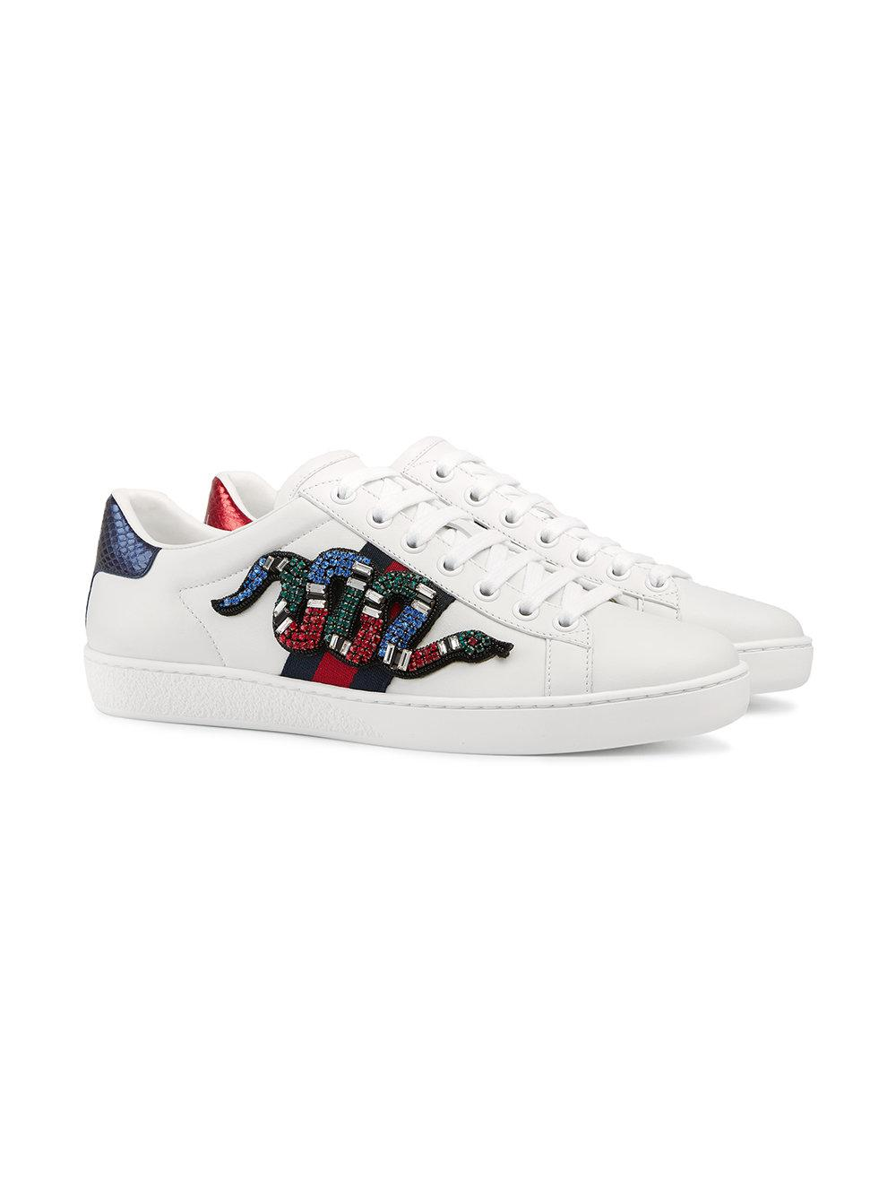 the latest 00c86 c3c04 Lyst - Baskets brodées Ace Gucci en coloris Blanc