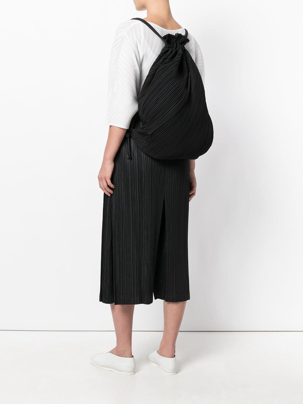 Lyst - Pleats Please Issey Miyake Pleated Drawstring Backpack in Black 07119a3a09a85
