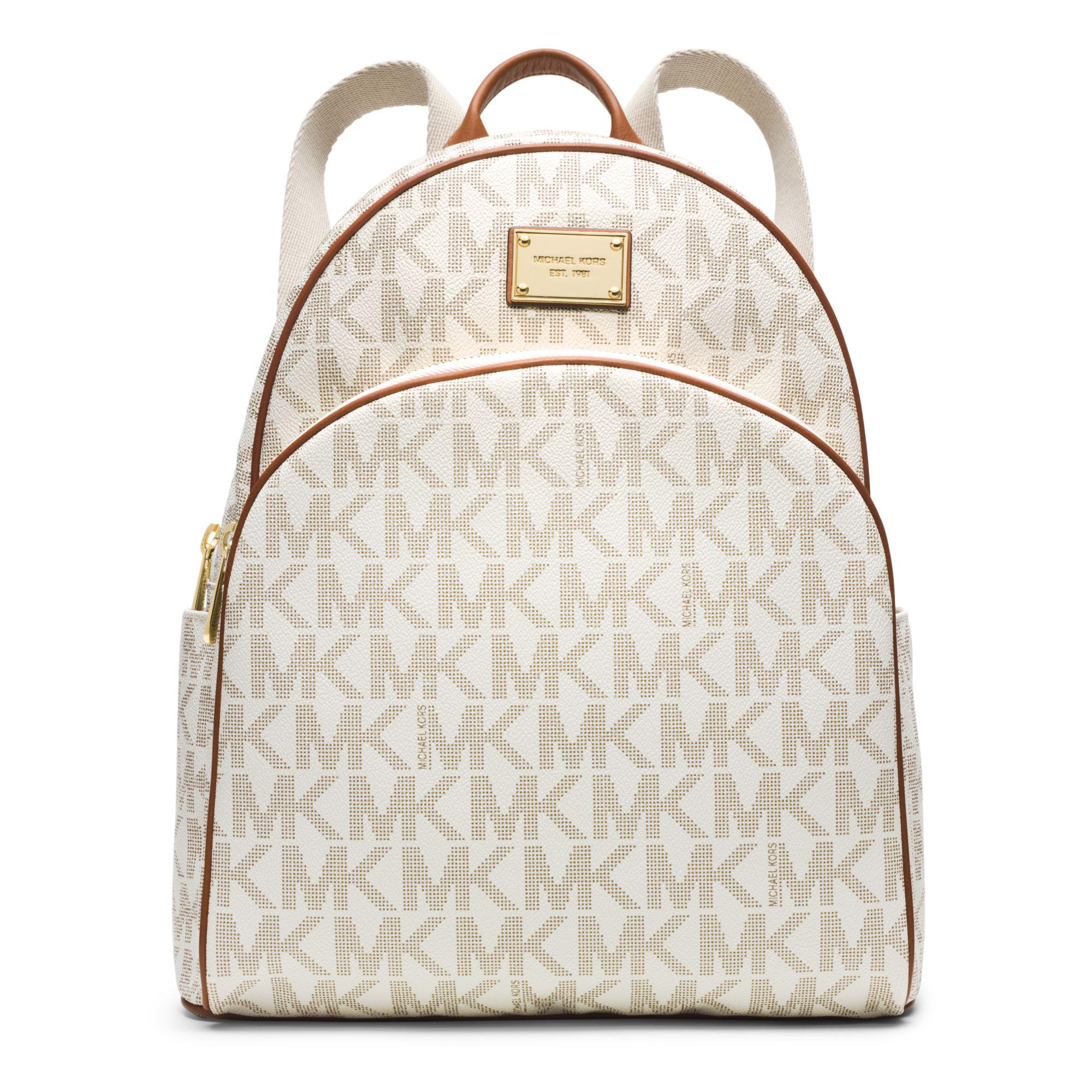 3e590c5bc755 ... greece michael kors jet set travel logo backpack in natural lyst 87eba  e4b00