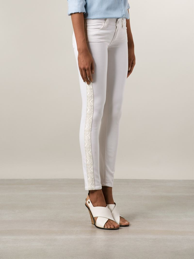 Paige Embroidered Side Skinny Jeans in White | Lyst