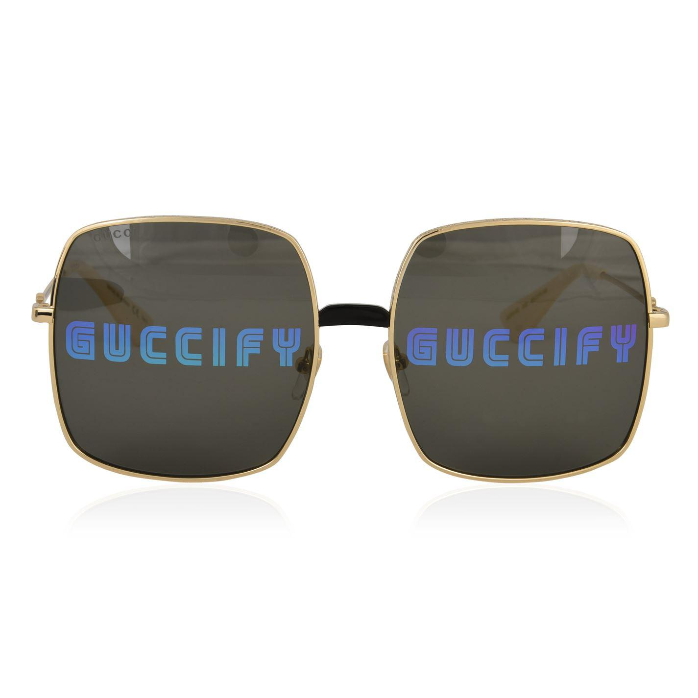 c675b262be8 Gucci. Women s Rectangular Frame Metal Sunglasses
