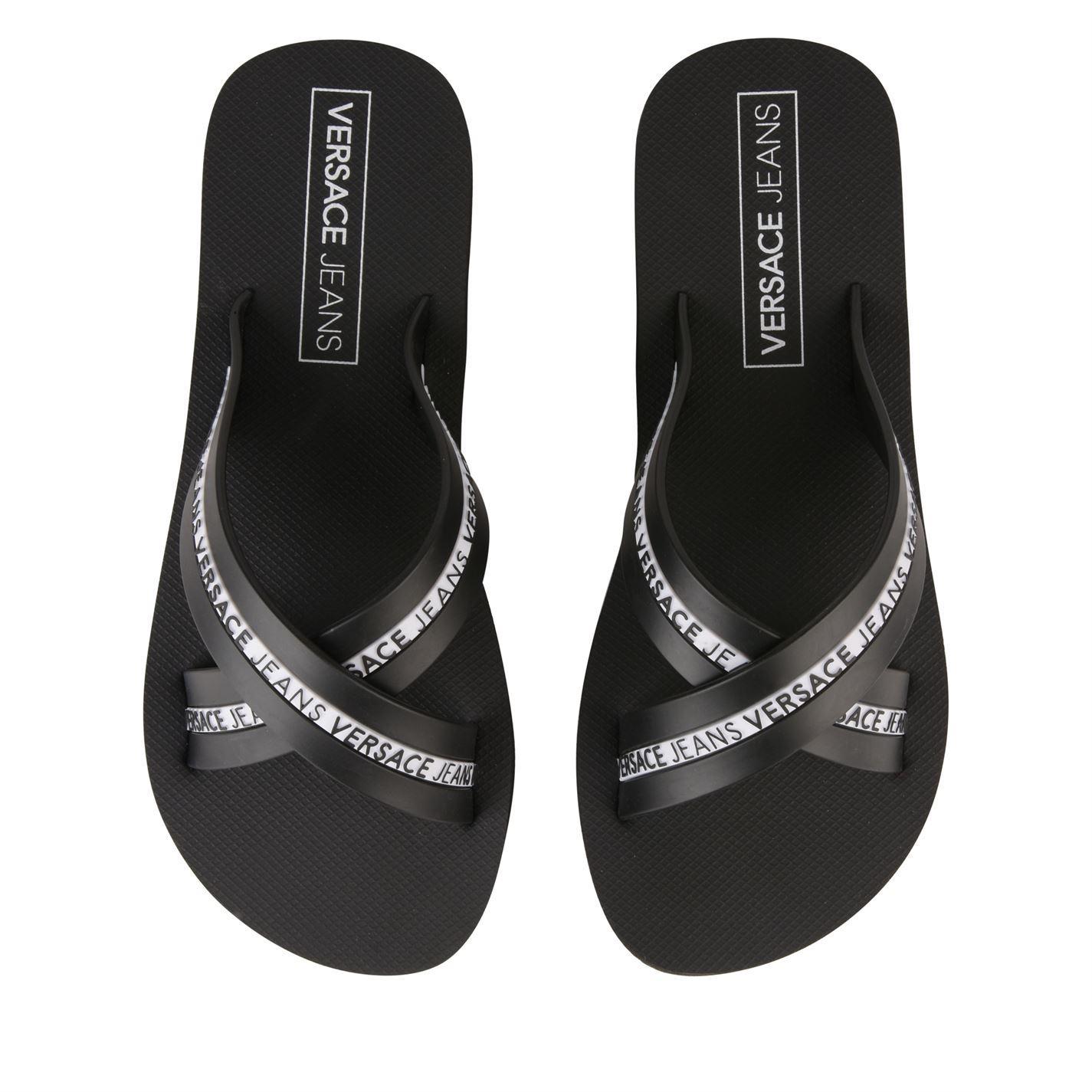 5e542522cf33 Versace Jeans Mare Logo Flip Flops in Black - Lyst