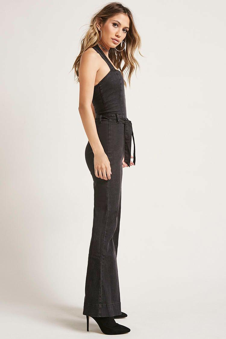 2b6351fa164 Lyst - Forever 21 Flared Denim Jumpsuit in Black