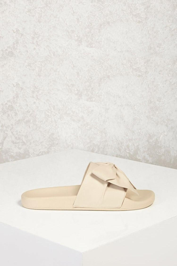 14e578d3d1ea3b Lyst - Forever 21 Faux Leather Bow Slide Sandals in Natural