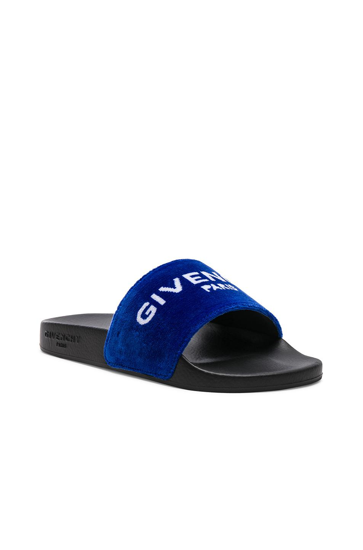 140518548e26 Lyst - Givenchy Logo Slide Sandals in Blue