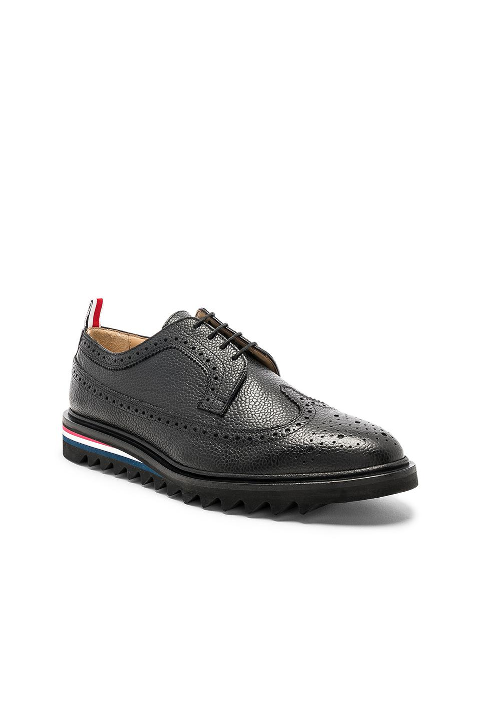 Thom Browne Pebble Grain Classic Longwing Brogue with Threaded Rubber Sole in . 2VGGFbJaWn