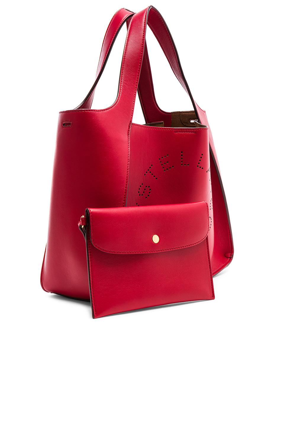 Stella McCartney Perforated Logo Crossbody Tote in Red