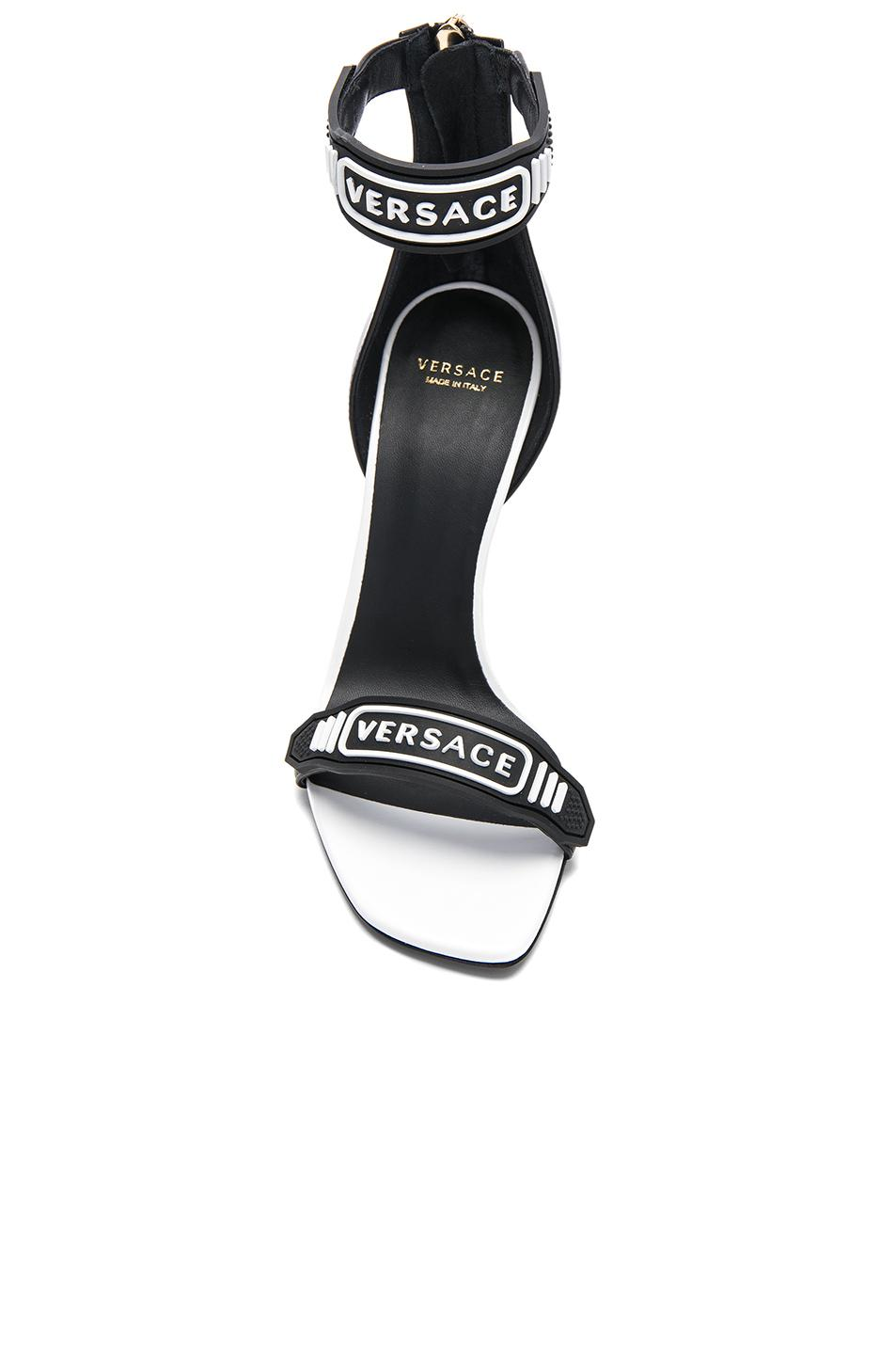 Versace Logo Ankle Strap Leather Sandals In Black Amp White