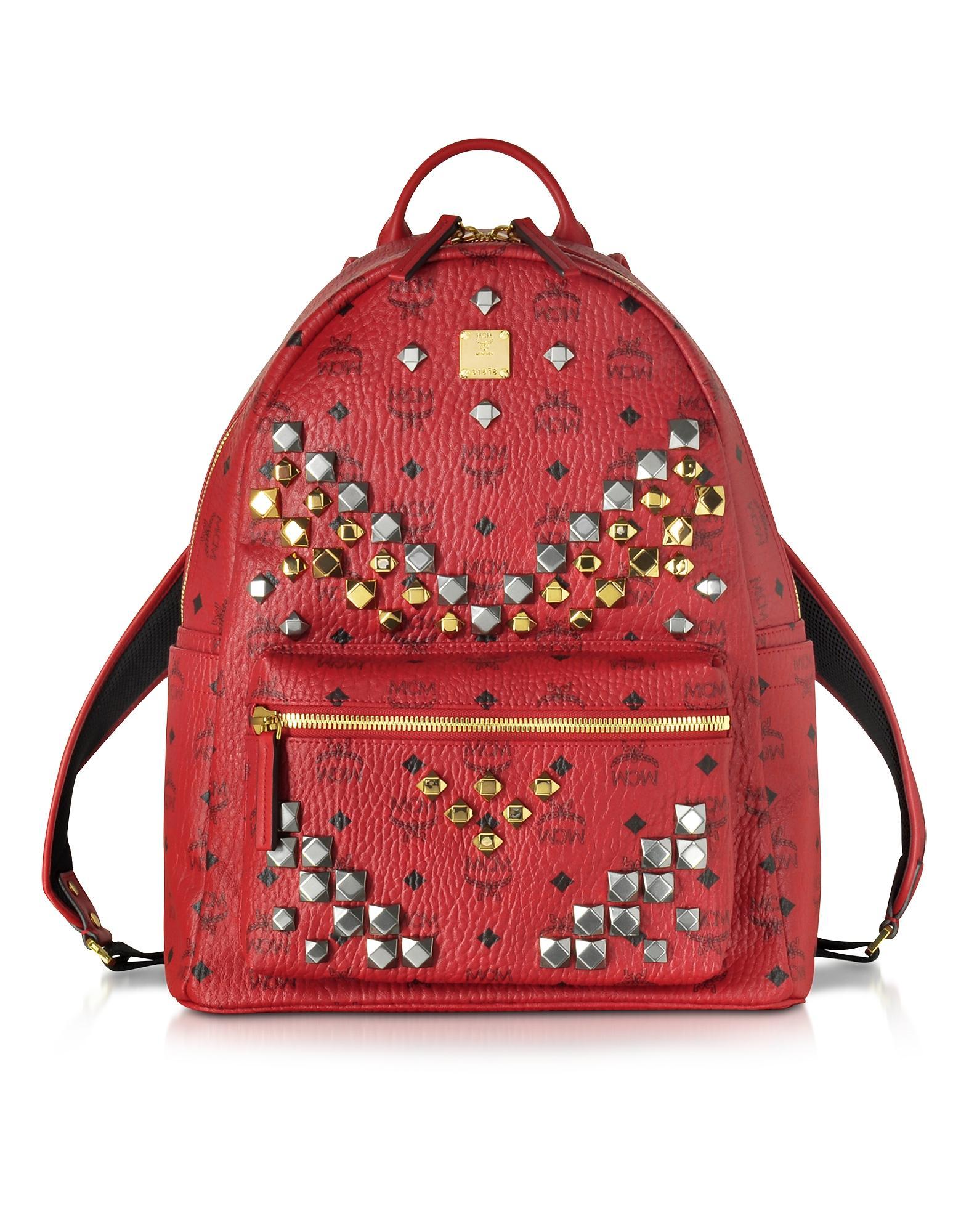 mcm stark ruby red medium backpack w studs lyst. Black Bedroom Furniture Sets. Home Design Ideas
