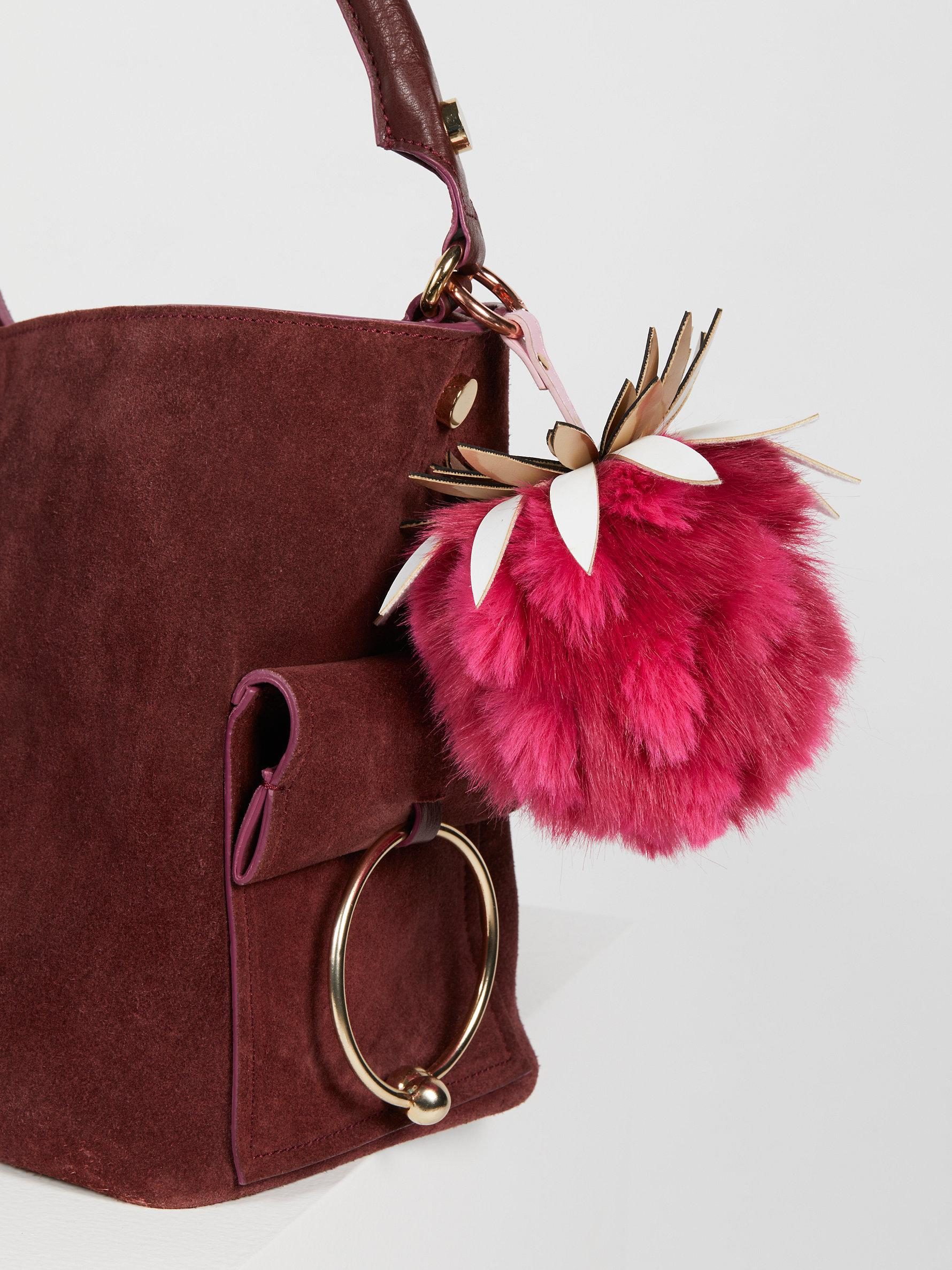 4f6c4432d5 Lyst - Free People Pineapple Faux Fur Bag Charm in Pink