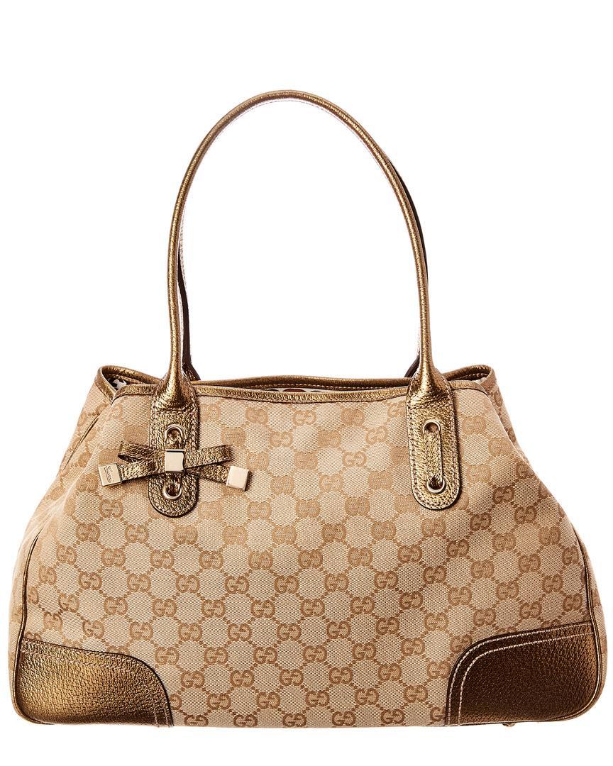 de95cde9c26 Gucci. Women s Gold GG Canvas   Leather Princy Tote