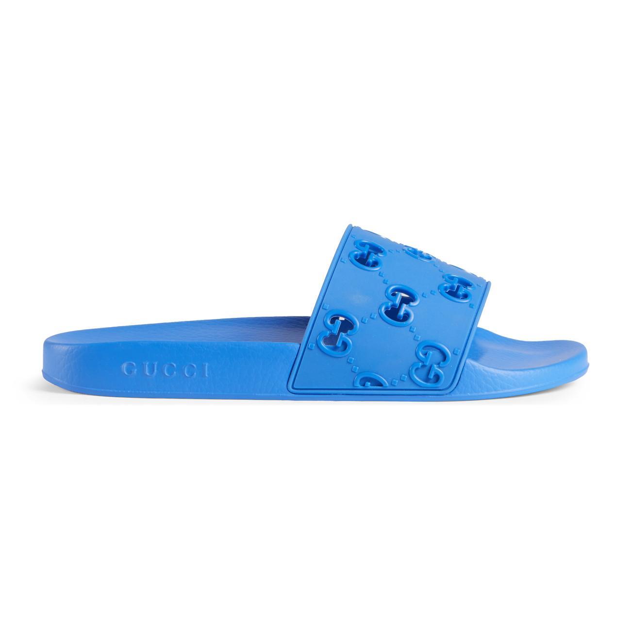 2a3b7e58ddd Lyst - Gucci Men s Rubber GG Slide Sandal in Blue for Men
