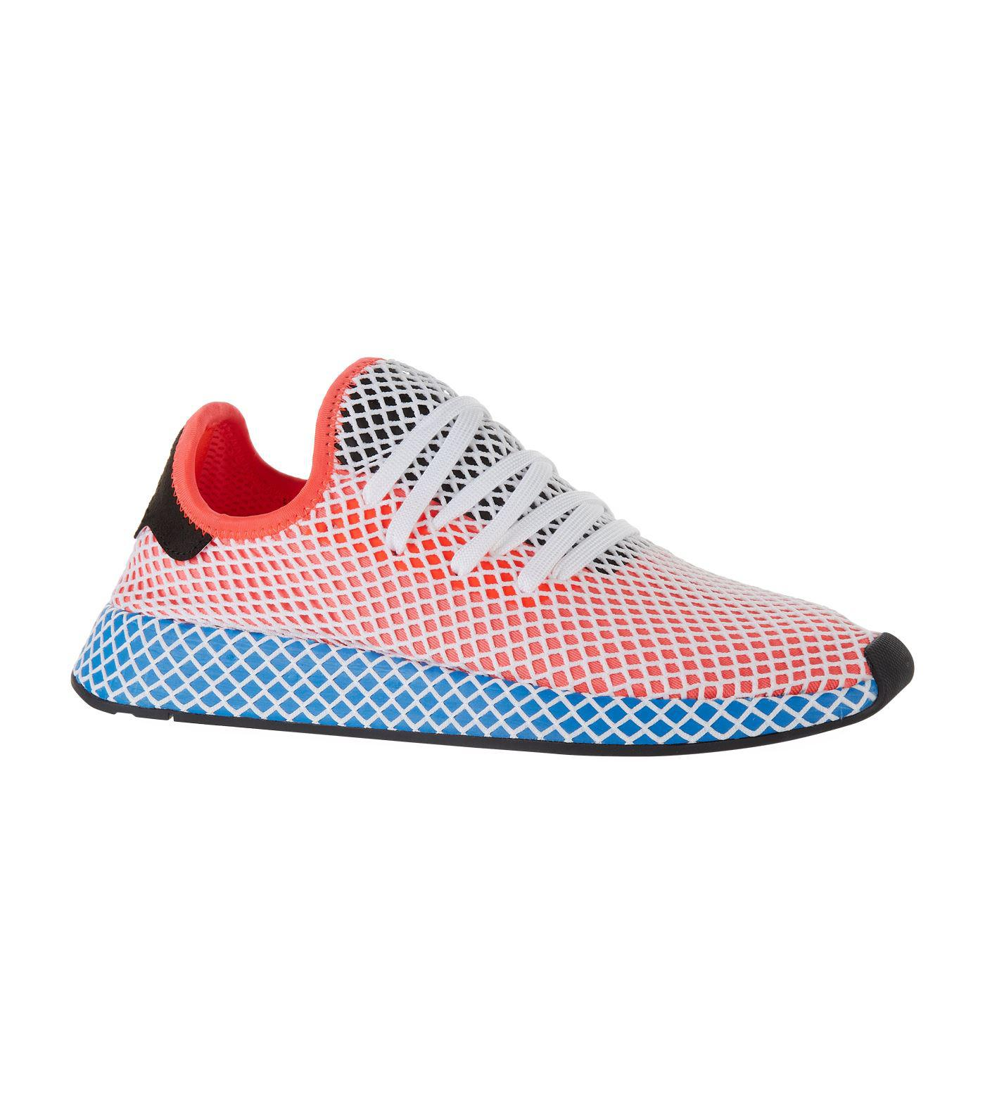 adidas originali deerupt runner formatori in rosso lyst