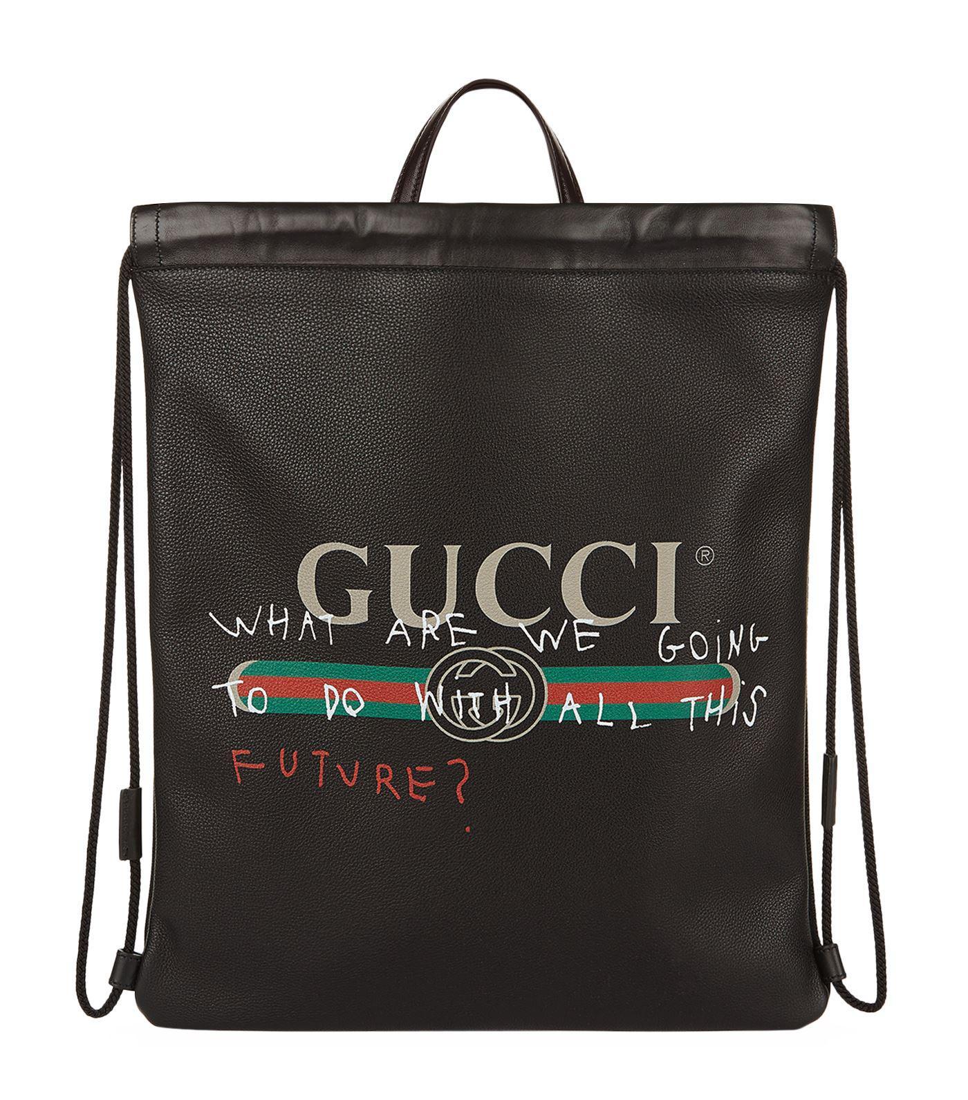 c1d7677360c7 Gucci Slogan Logo Print Drawstring Bag in Black - Lyst