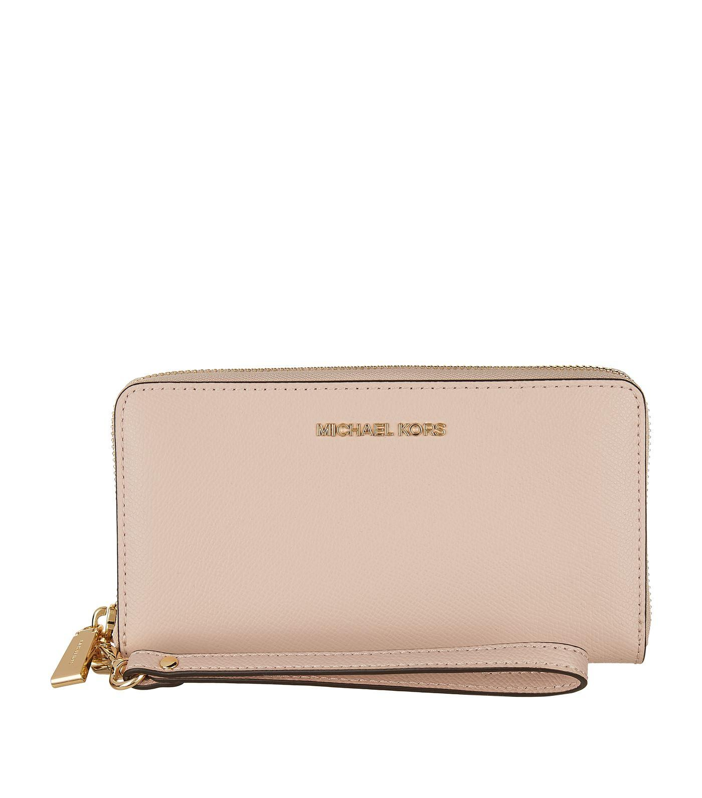 1187a3c5c5a2 Lyst - MICHAEL Michael Kors Leather Wristlet Wallet in Pink - Save ...