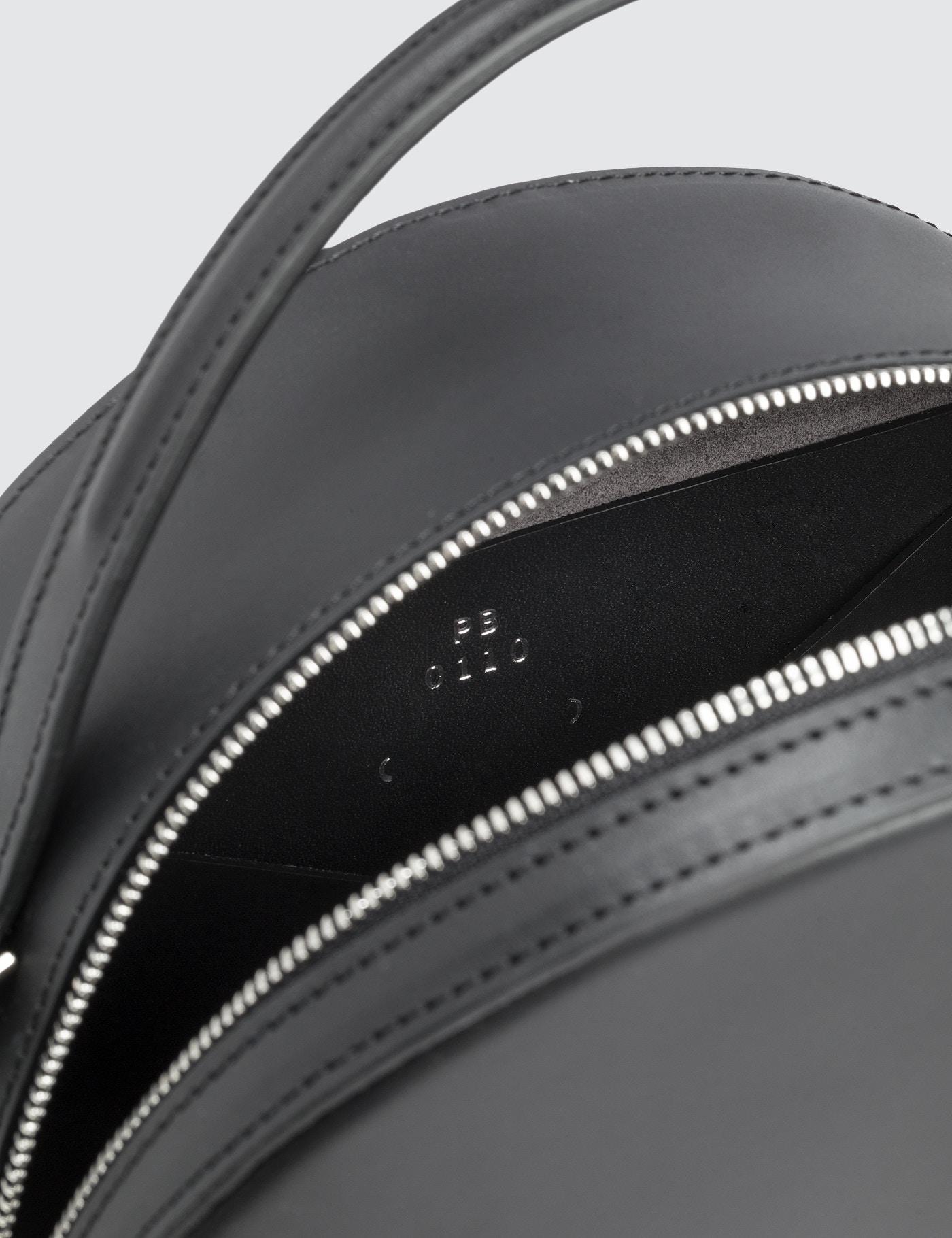 PB 0110 Leather Round Cross-body Bag in Black