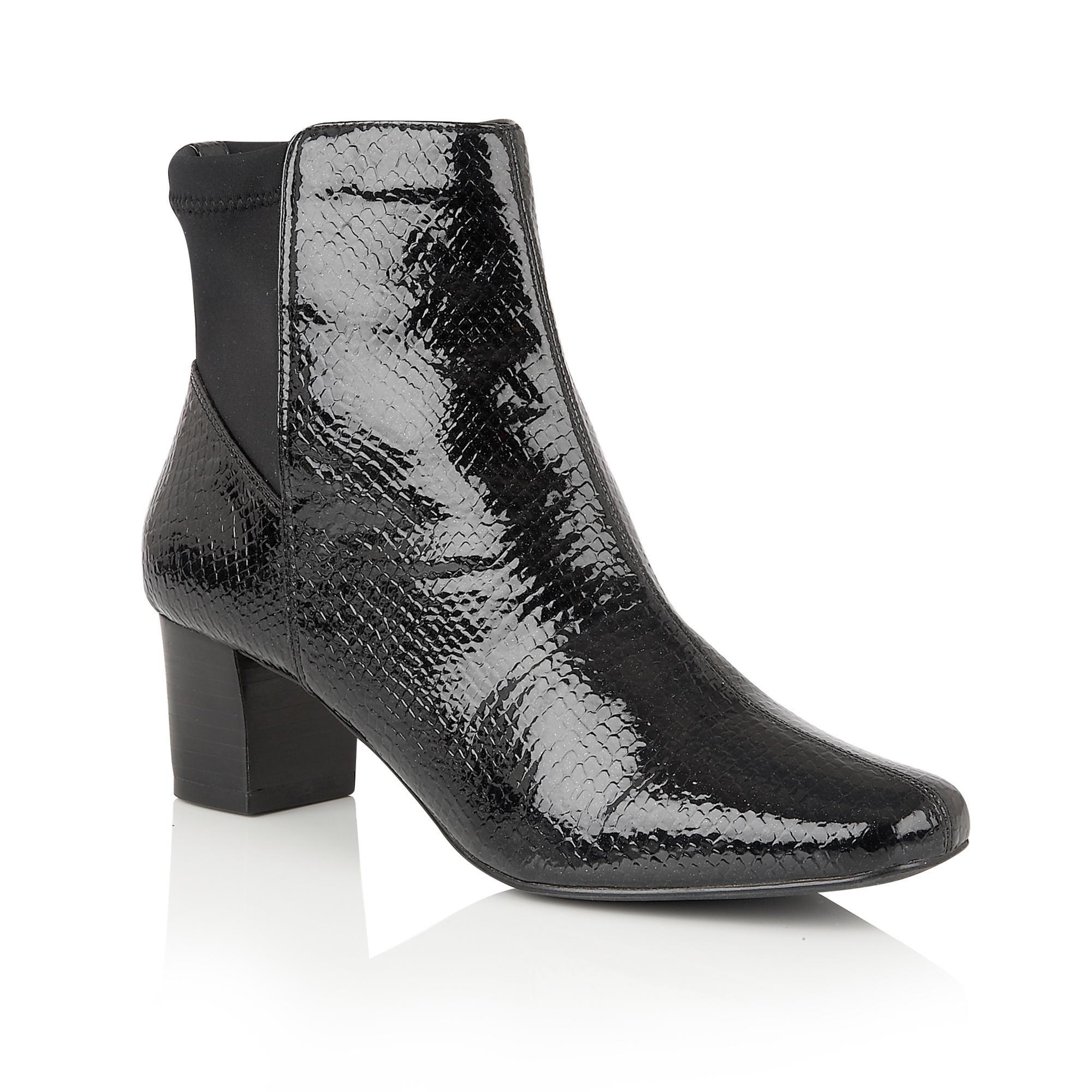 lotus animal print ankle boots in black lyst