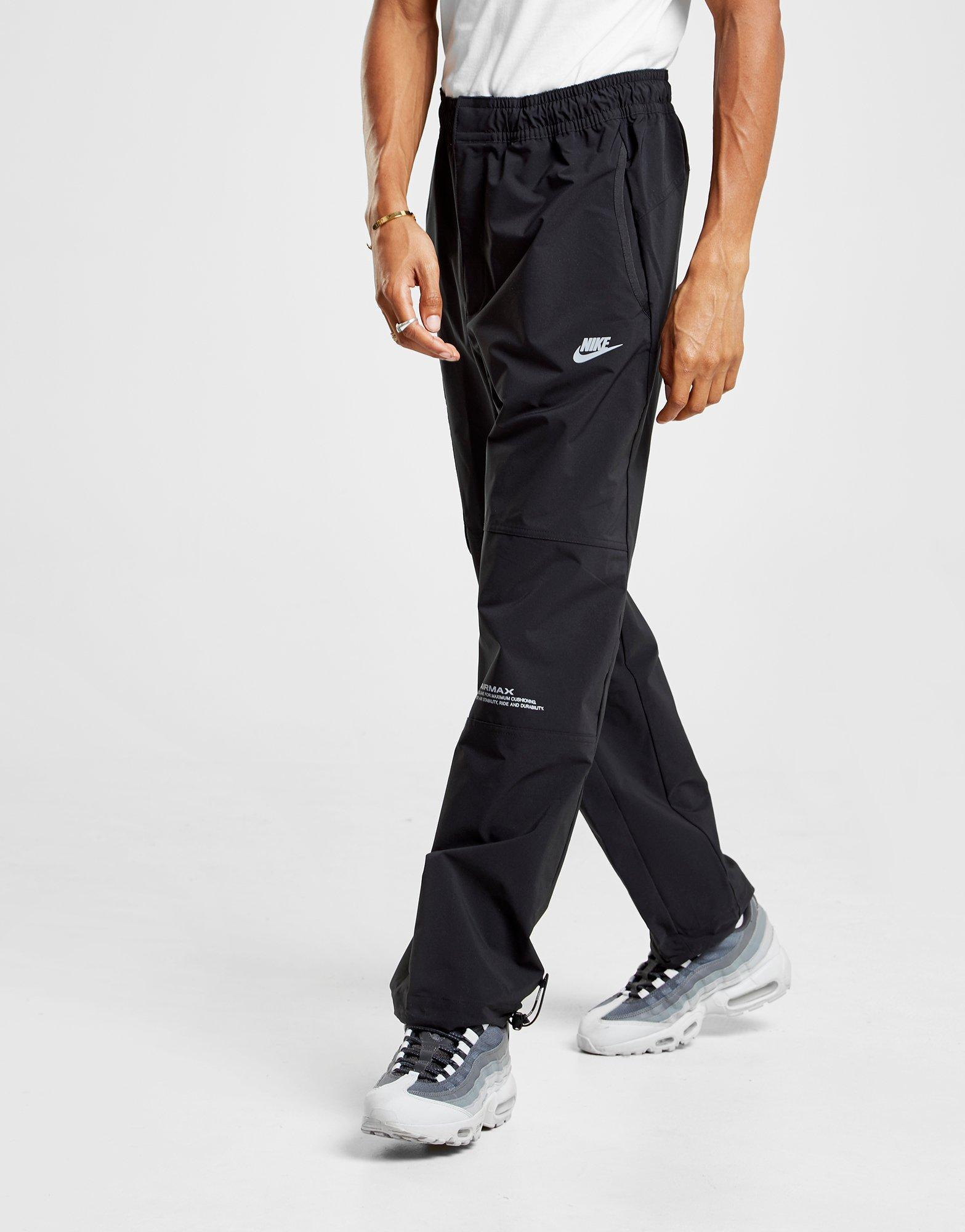 ea52c369f220 Nike Air Max Woven Track Pants in Black for Men - Lyst