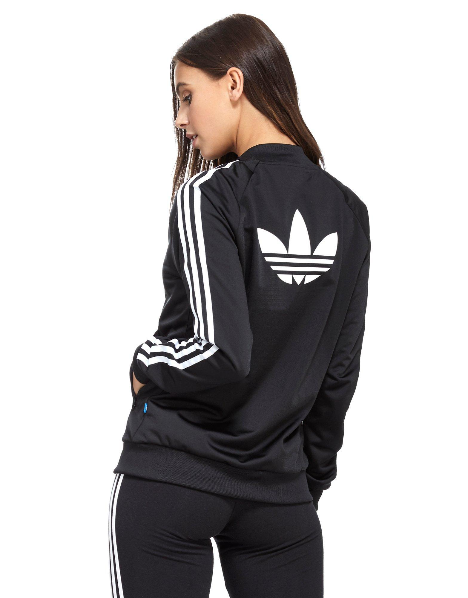 lyst adidas originals supergirl track top in black. Black Bedroom Furniture Sets. Home Design Ideas