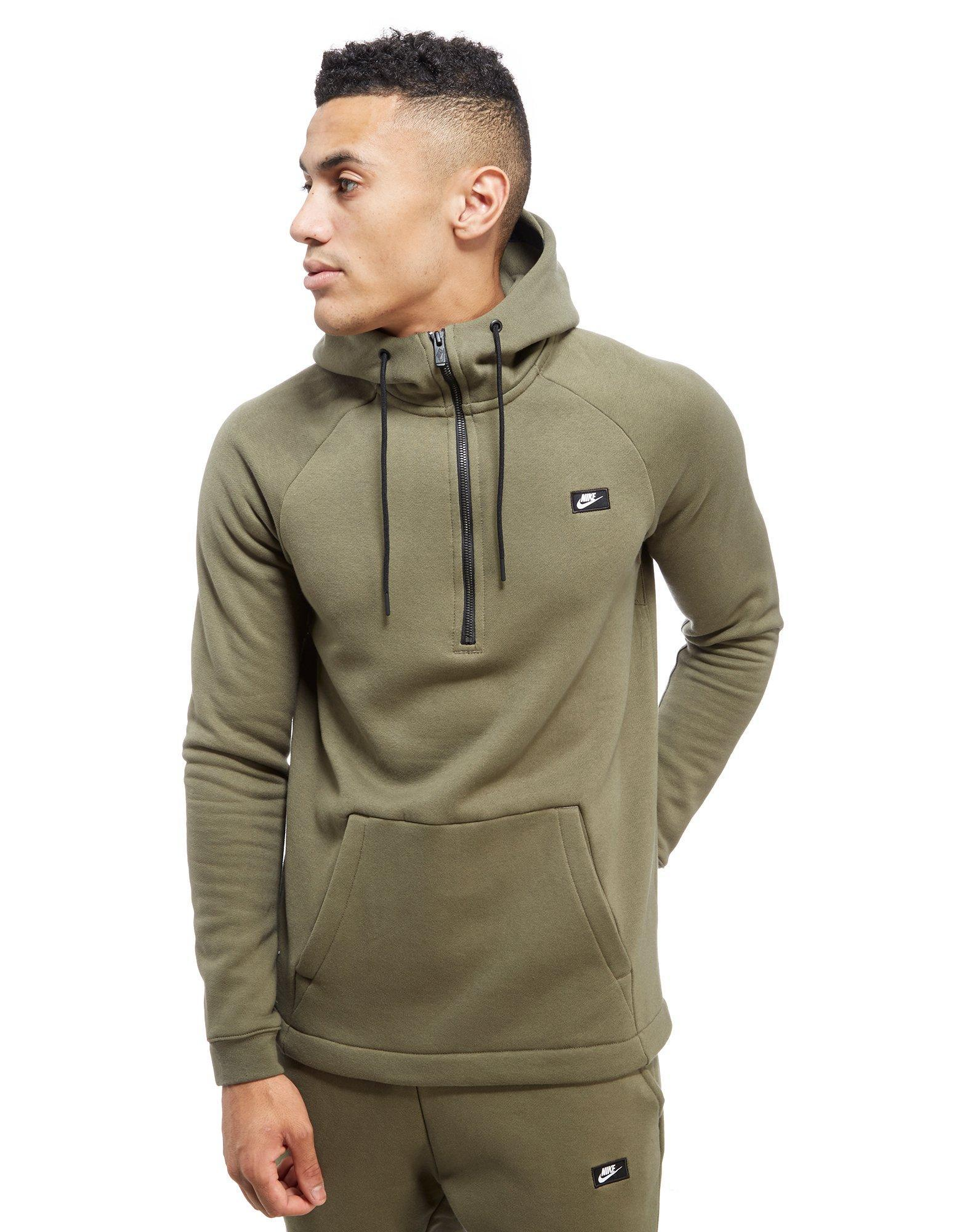 Lyst nike modern half zip hoody in green for men for Dress shirts for athletic guys
