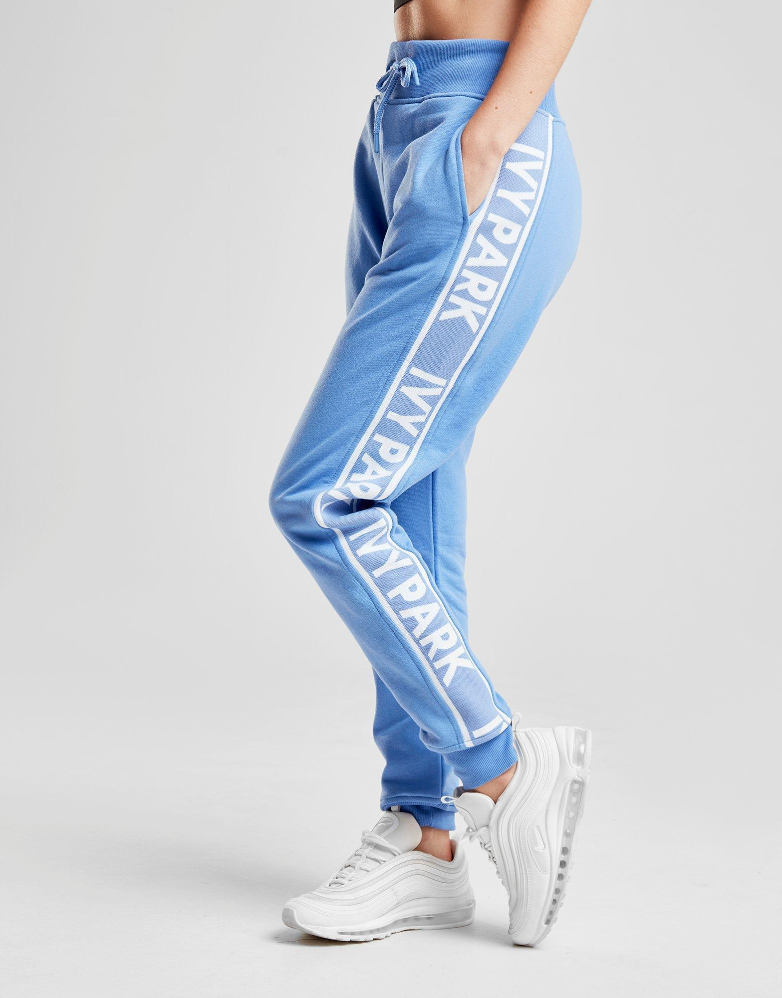 f85737362029 Lyst - Ivy Park Logo Tape Joggers in Blue